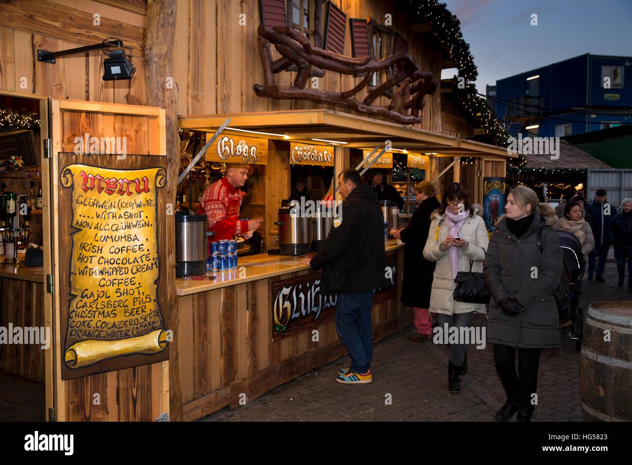 Denmark, Copenhagen, Kongens Nytorv, visitors amongst Christmas Market stalls - Stock Image