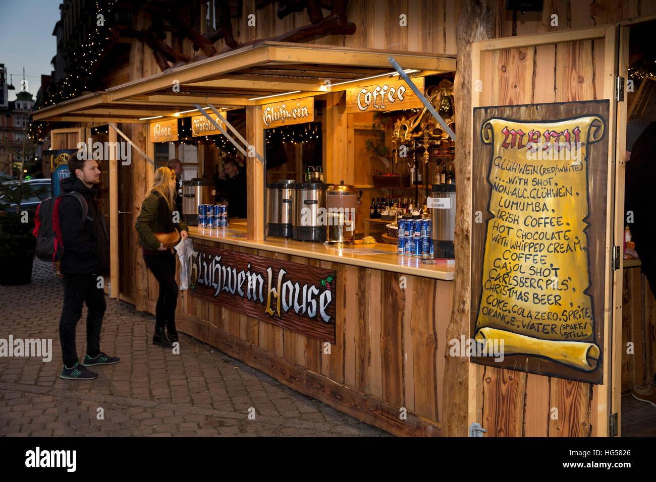 Denmark, Copenhagen, Kongens Nytorv, visitors at Christmas Market drinks stall - Stock Image