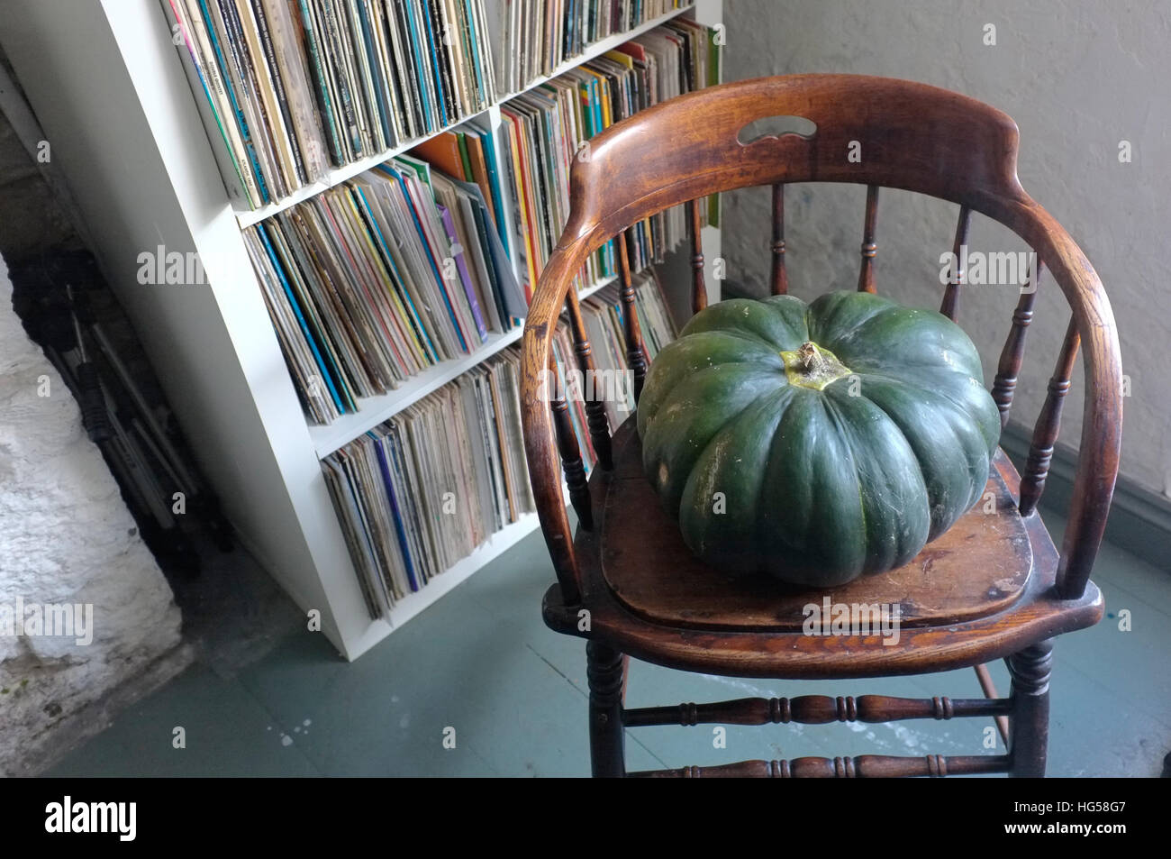 A large pumpkin/squash on a chair. - Stock Image