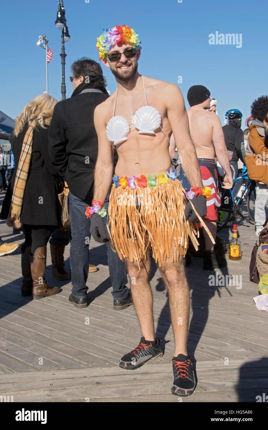An eccentric New York man in a bikini & hula skirt in Coney Island for the annual Polar Bear Club swim. In Brooklyn, - Stock Image