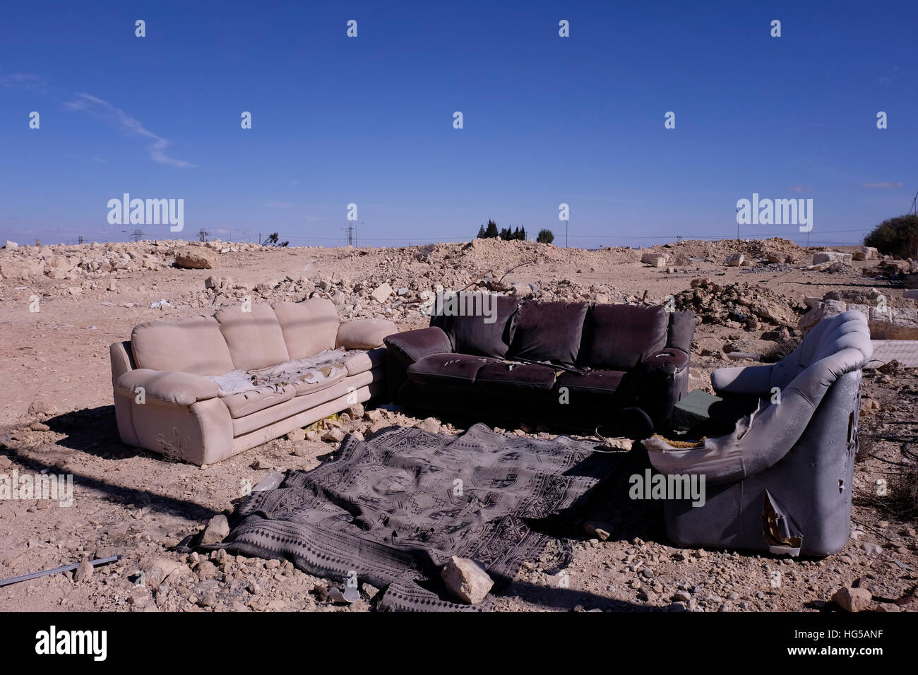Abandoned Sofa and couches in Mitzpe Ramon a town in the Negev desert on 03 January 2016.  Mitzpe Ramon comprises - Stock Image