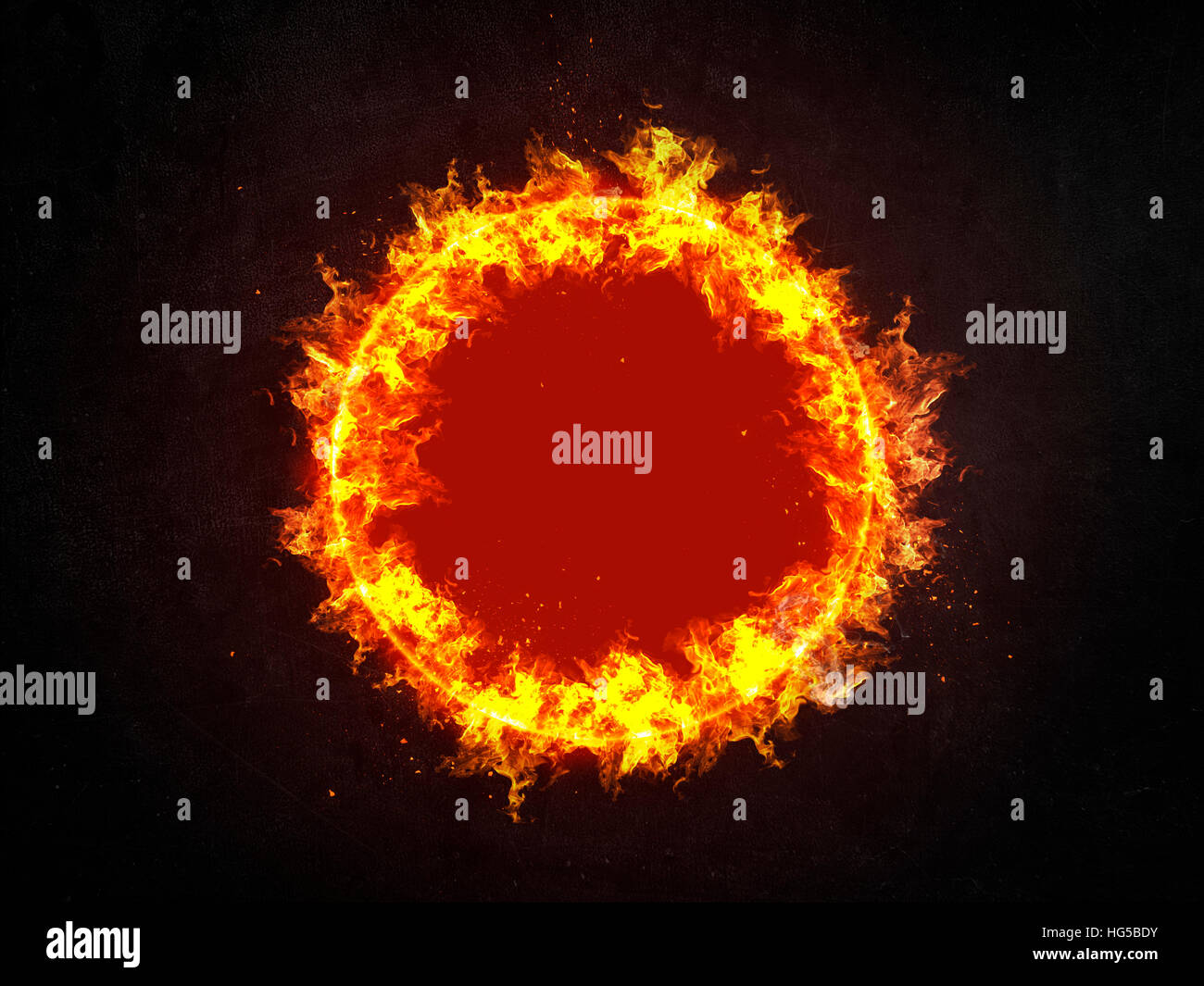 Burning ring of fire with red hot central copy space and showering sparks centered over a dark background - Stock Image
