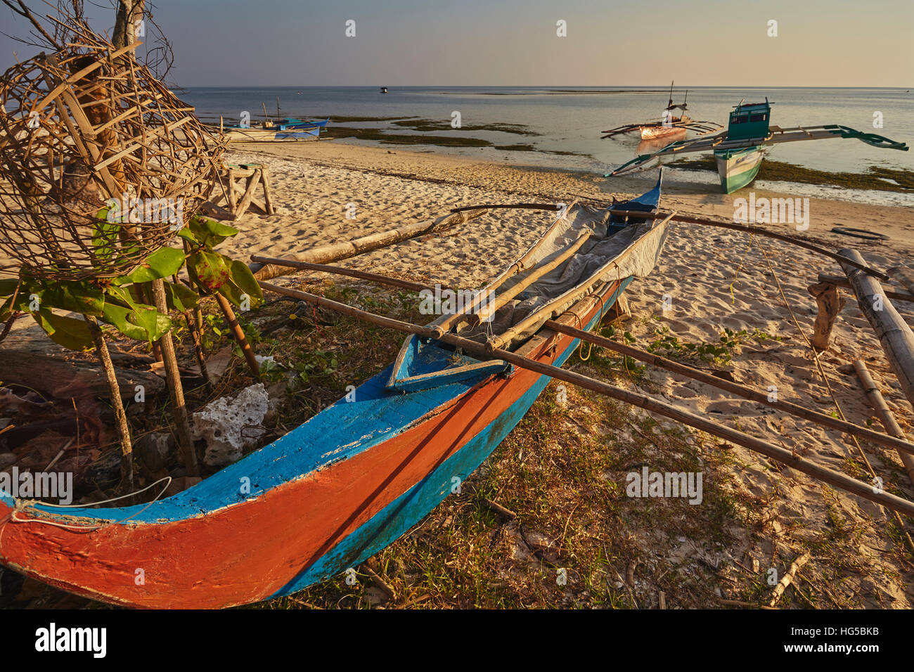 Fishing boats pulled up onto Paliton beach, Siquijor, Philippines, Southeast Asia, Asia - Stock Image