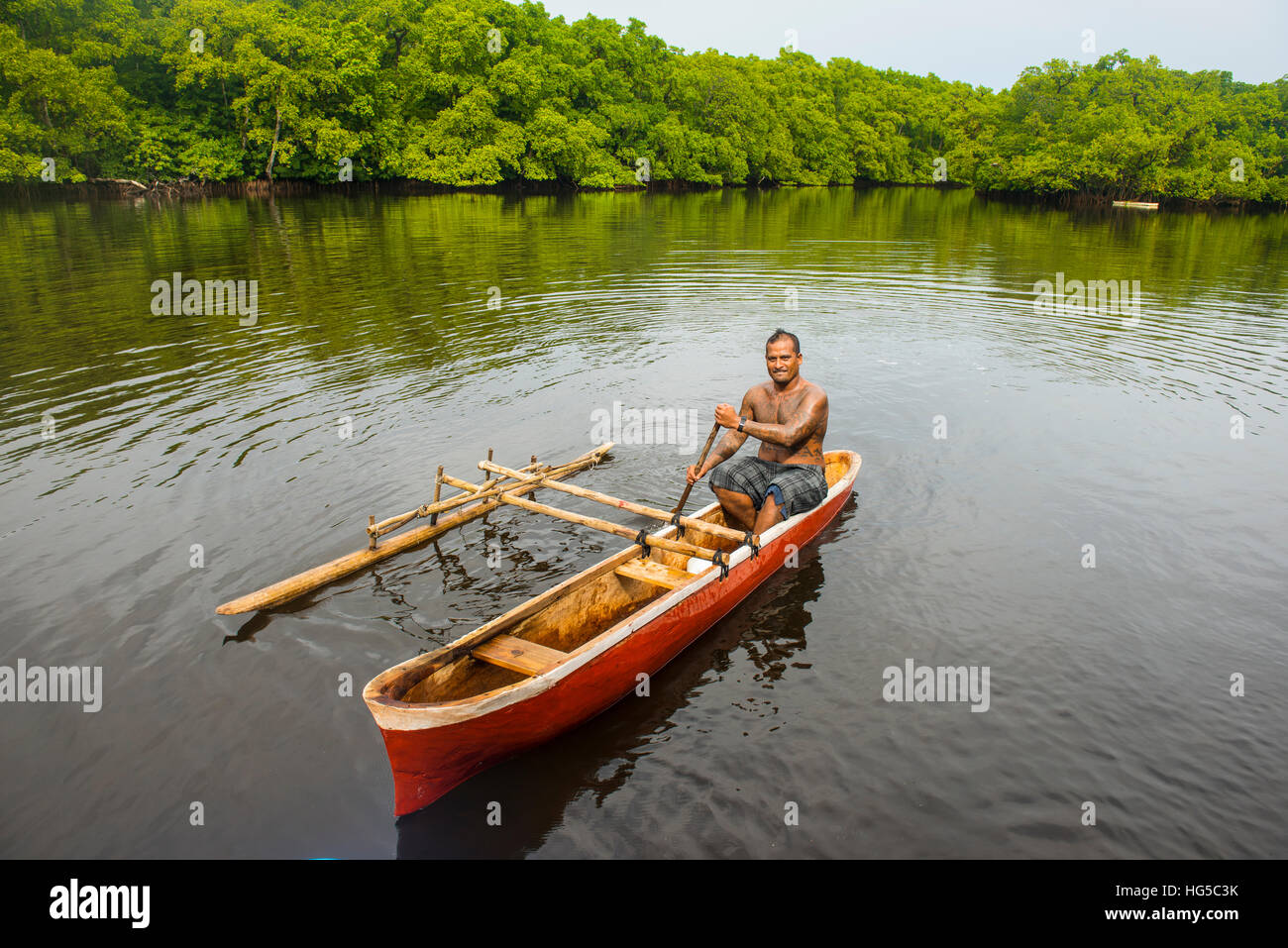 Man in his dugout canoe, Kosrae, Federated States of Micronesia, South Pacific Stock Photo