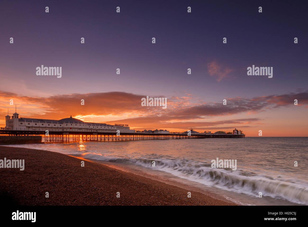 Brighton Pier and beach at sunrise, Brighton, East Sussex, Sussex, England, United Kingdom - Stock Image
