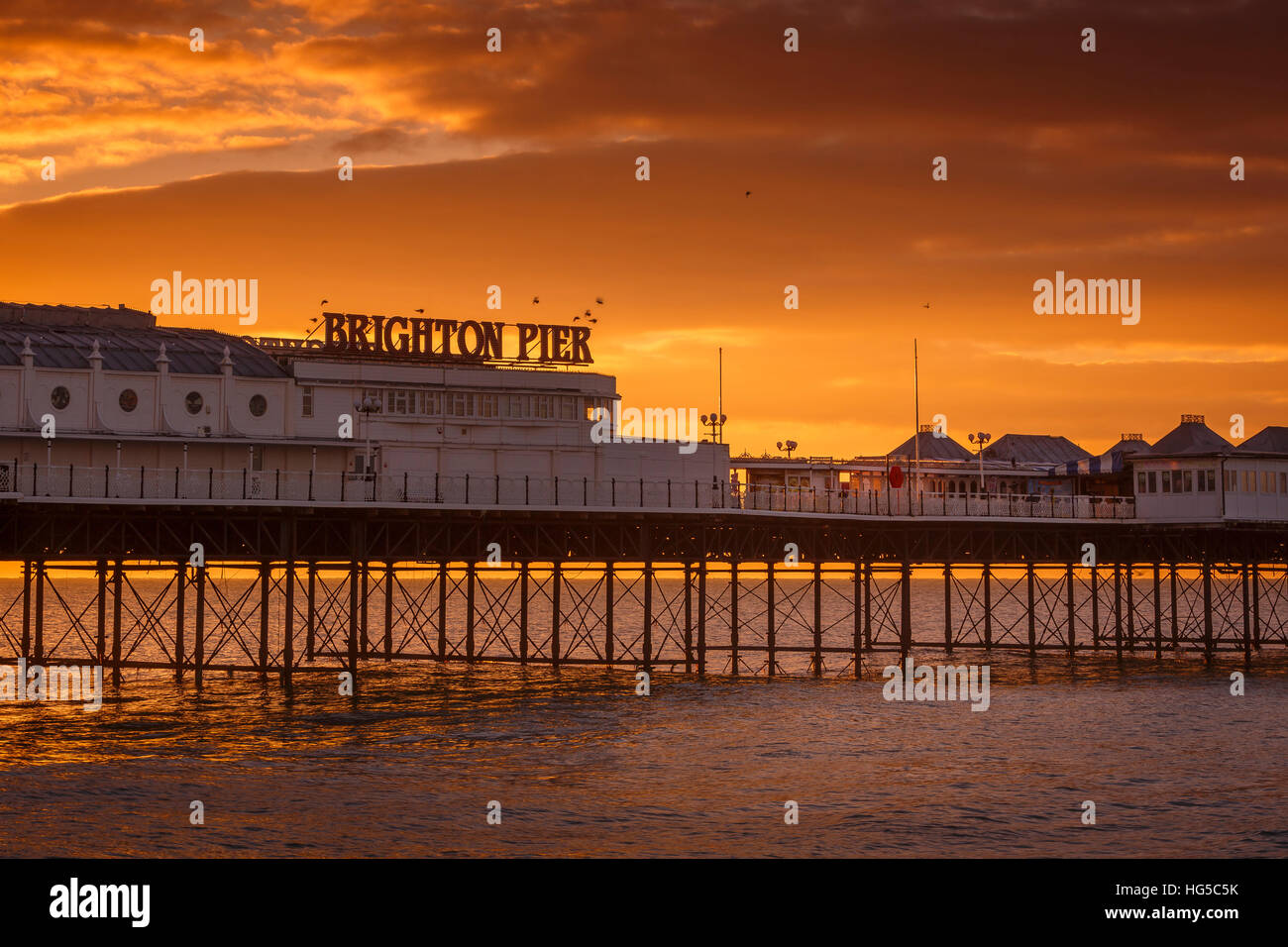 Brighton Pier at sunrise, Brighton, East Sussex, Sussex, England, United Kingdom - Stock Image