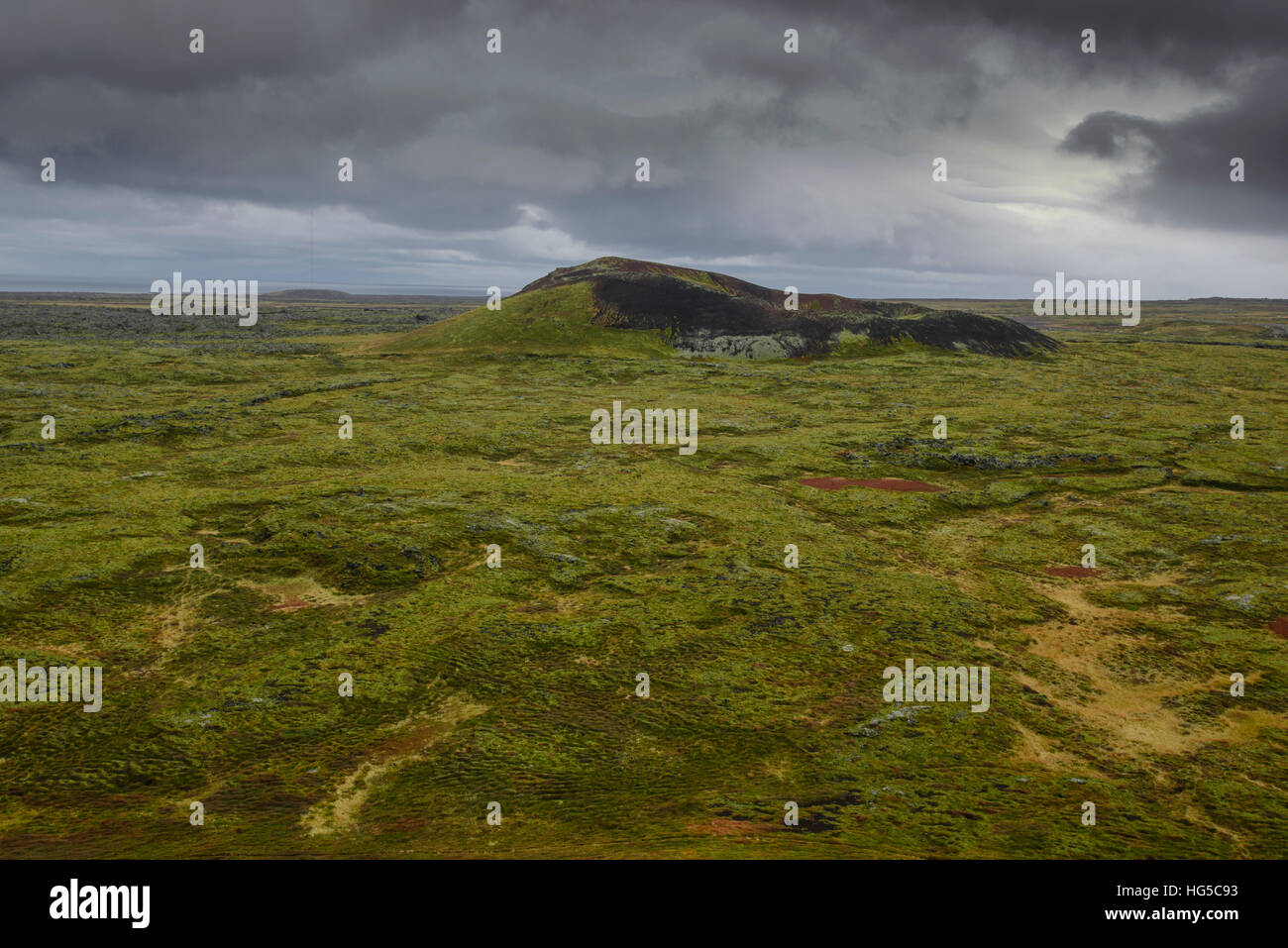 Volcanic crater and moss-covered lava fields on the Snaefellsness Peninsula, Iceland, Polar Regions - Stock Image