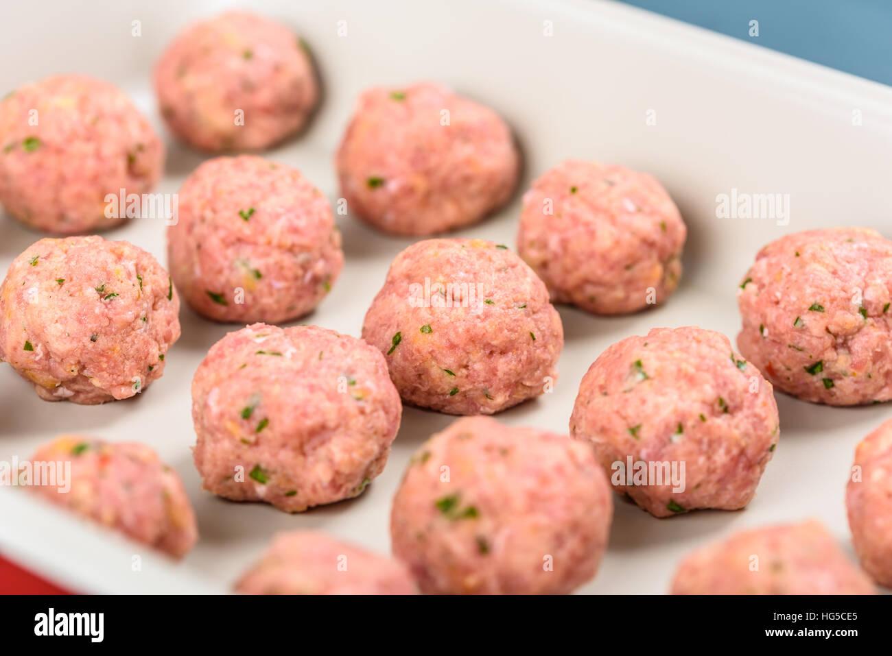 Preparing Raw Meatballs In Pan - Stock Image