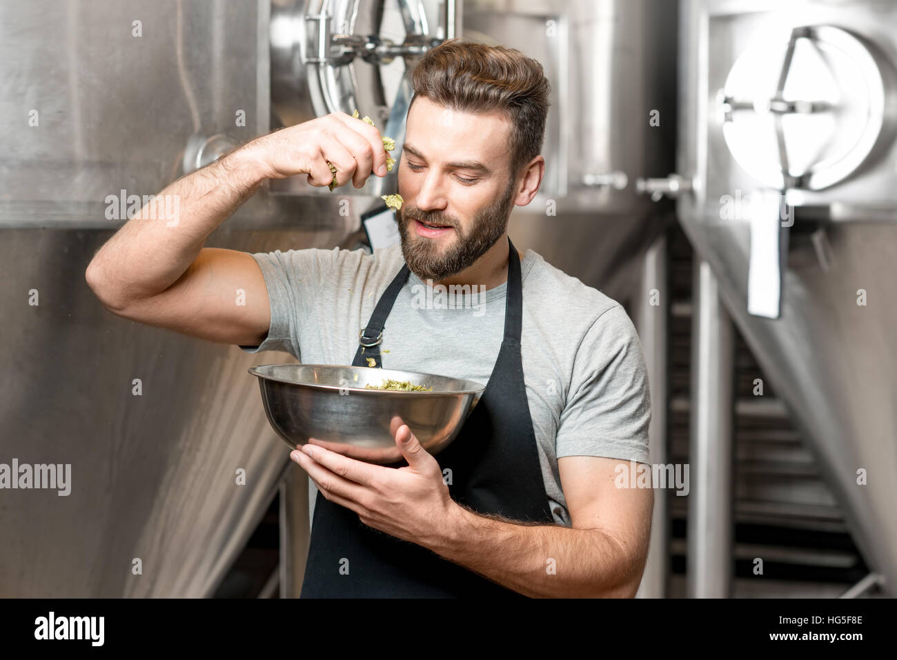 Brewer at the beer manufacturing - Stock Image