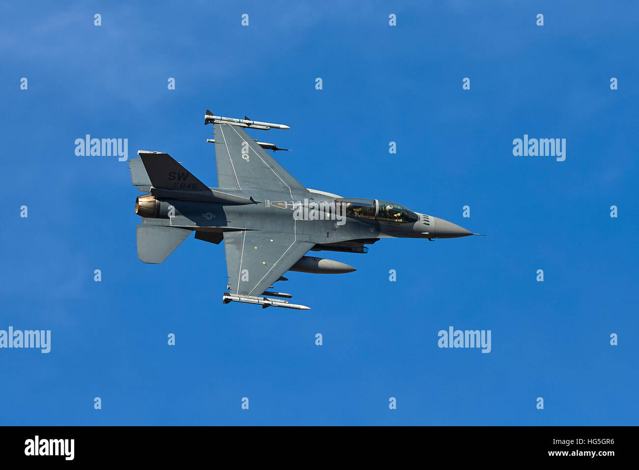 USAF F-16D Fighting Falcon, Banking Over Death Valley, California. - Stock Image