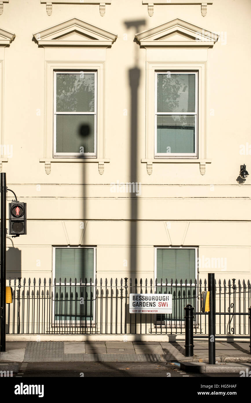 Pedestrian crossing and shadow of high viewpoint security camera, Bessborough Gardens, London - Stock Image
