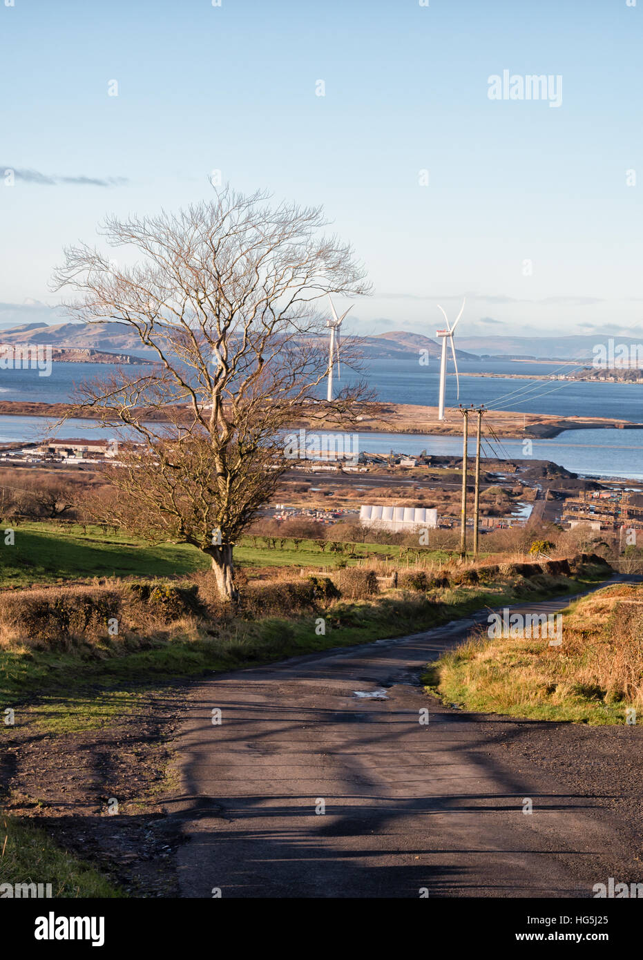 Fairlie Moor Looking onto Wind Turbines and Arran in distance. Arran,Majestic,Cumbrae's,Clyde,Roadway,Leading - Stock Image