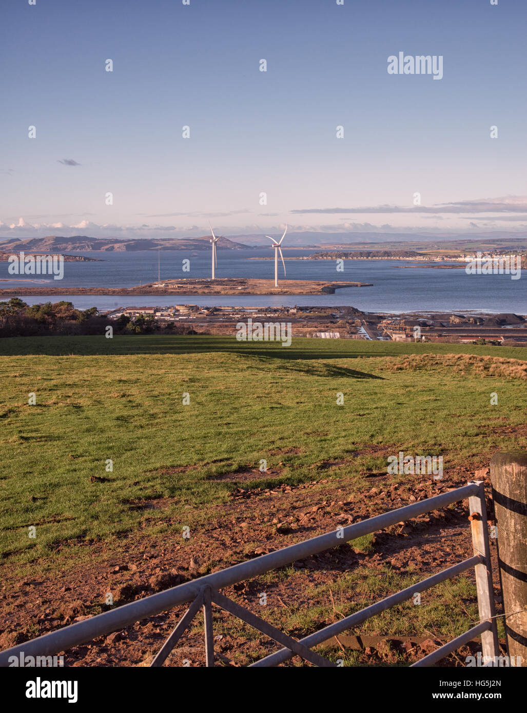 Fairlie Moor Looking onto Wind Turbines and Arran in distance - Stock Image