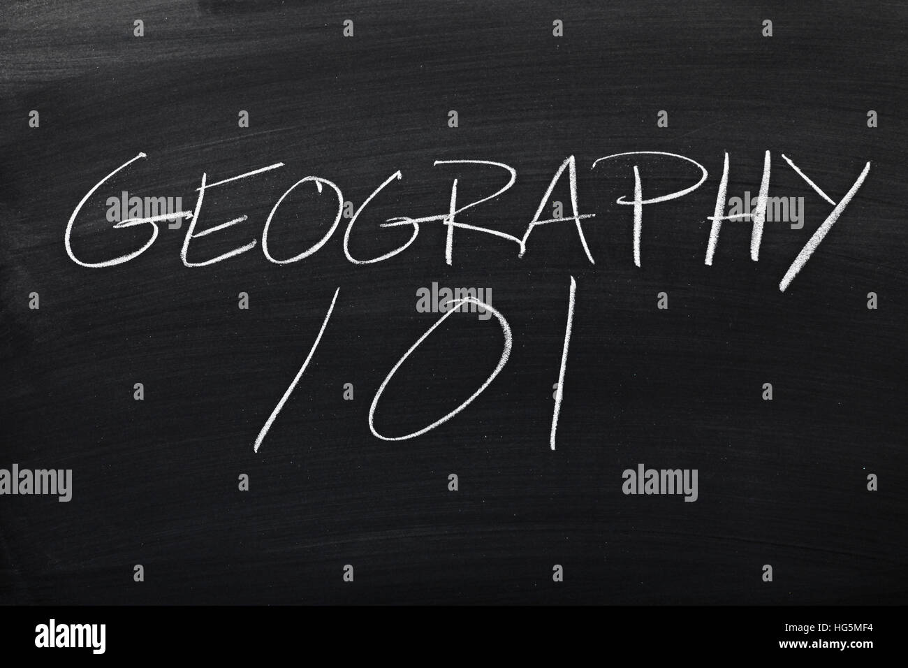 The words 'Geography 101' on a blackboard in chalk - Stock Image