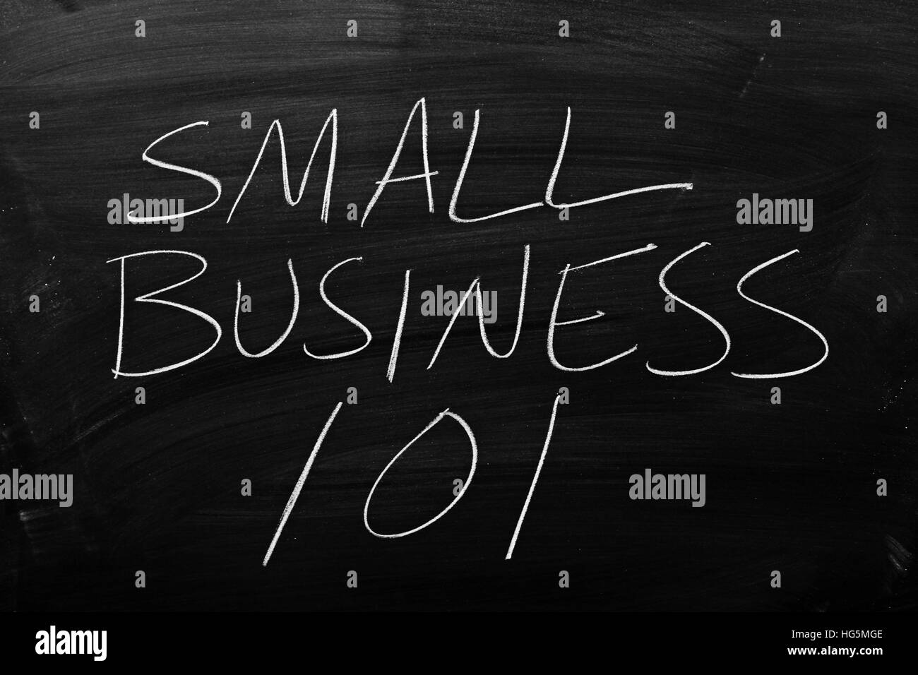 The words 'Small Business 101' on a blackboard in chalk - Stock Image