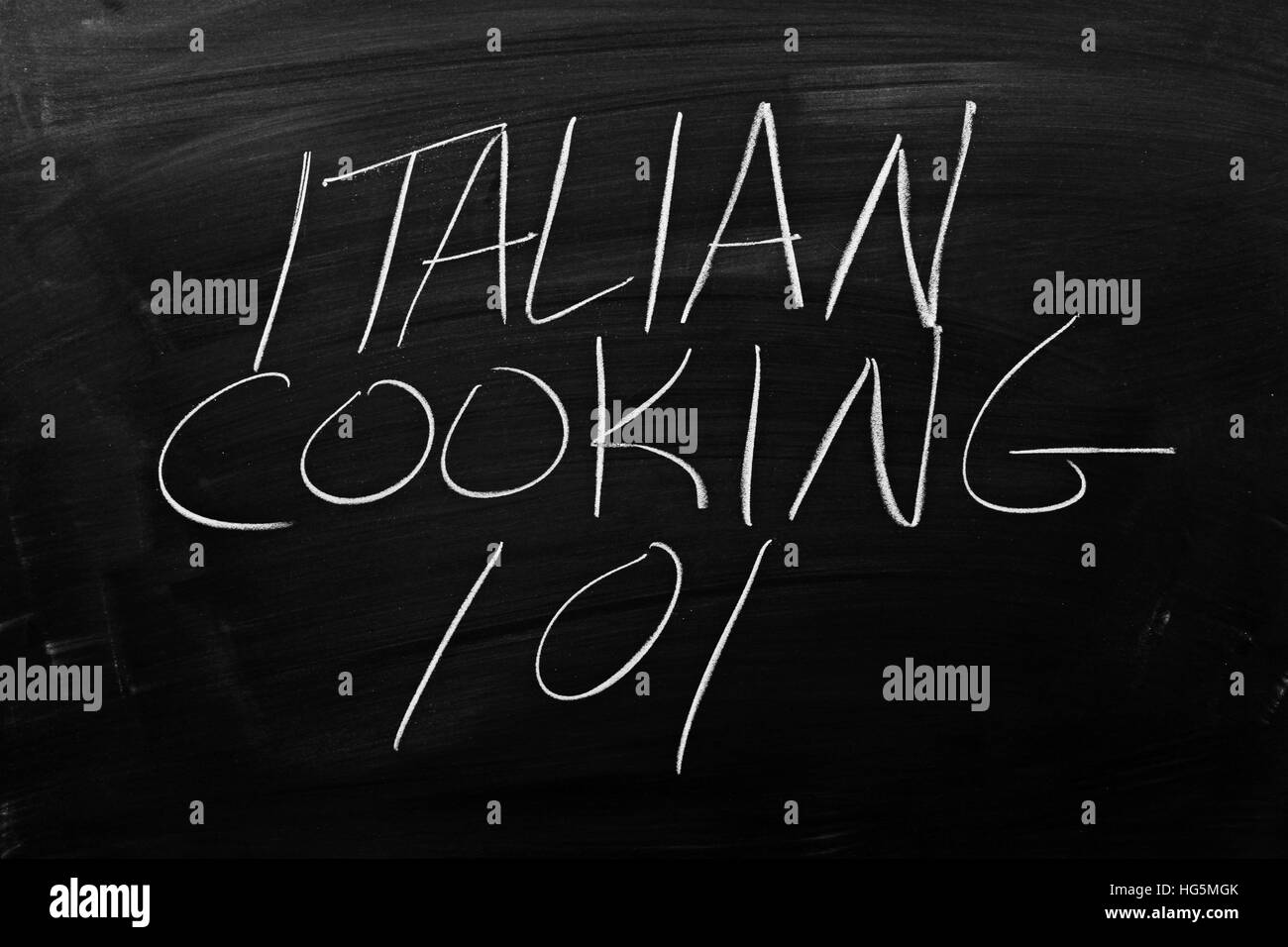 The words 'Italian Cooking 101' on a blackboard in chalk - Stock Image