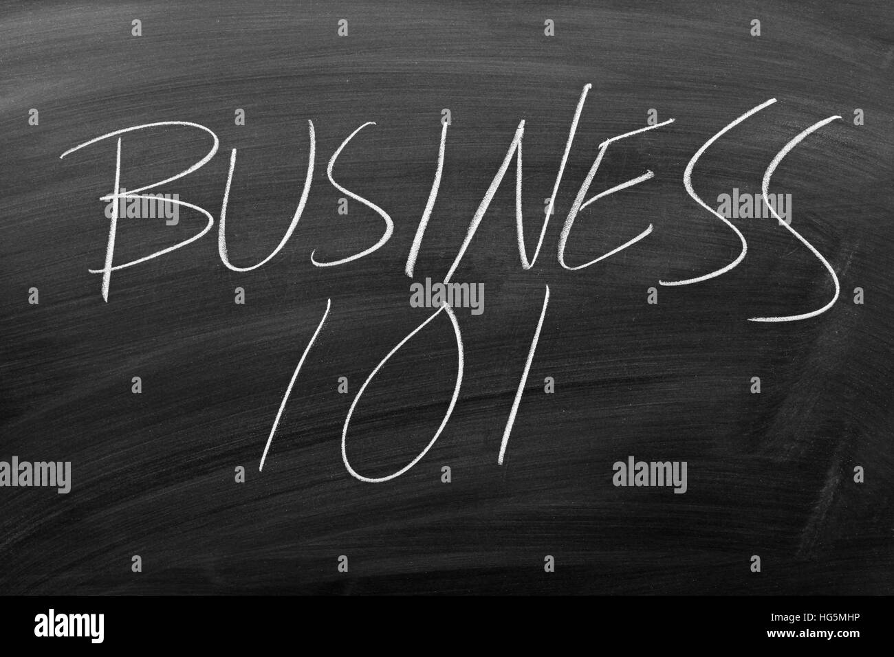 The words 'Business 101' on a blackboard in chalk - Stock Image