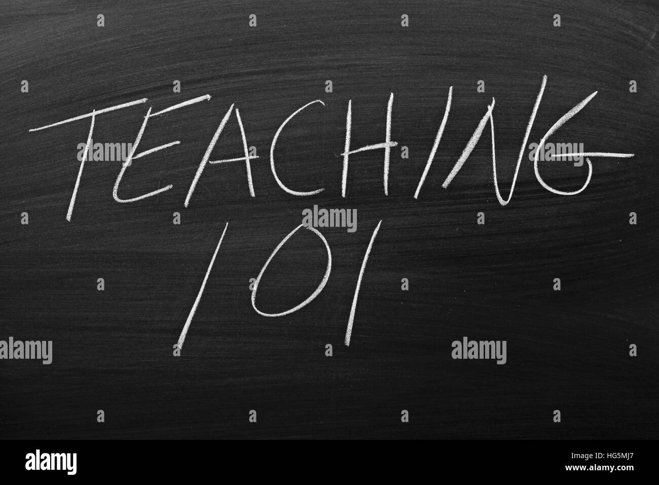 "The words ""Teaching 101"" on a blackboard in chalk Stock Photo"