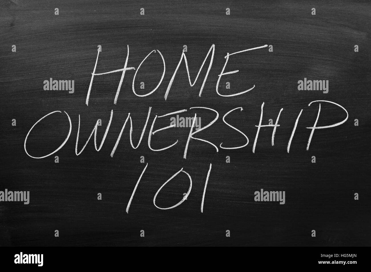 The words 'Home Ownership 101' on a blackboard in chalk - Stock Image