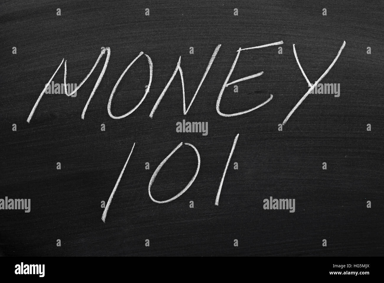 The words 'Money 101' on a blackboard in chalk - Stock Image