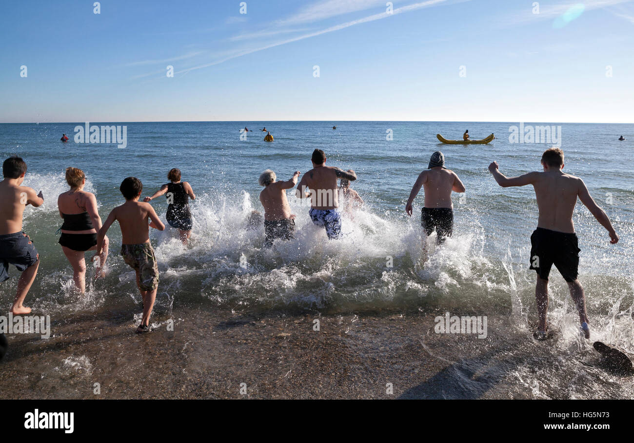 The annual Polar Bear Plunge into Lake Michigan takes place on New Year's Day in Milwaukee, Wisconsin. - Stock Image
