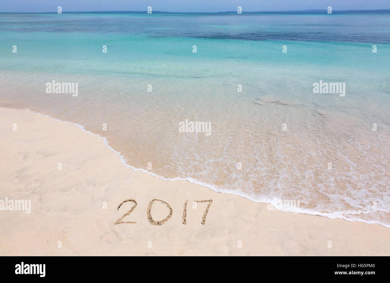 Happy New Year 2017 creative on the beach - Stock Image