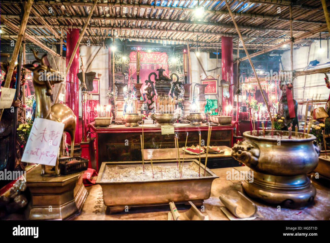Man Mo Temple on Hong Kong Island iconic incense idols gods prayer altar Hong Kong's only Man Mo Temple, built - Stock Image