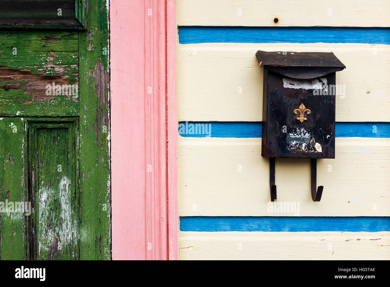 Detail Of The Facade Of A Colorful House In New Orleans, With An Old Mailbox  With The Fleur De Lis