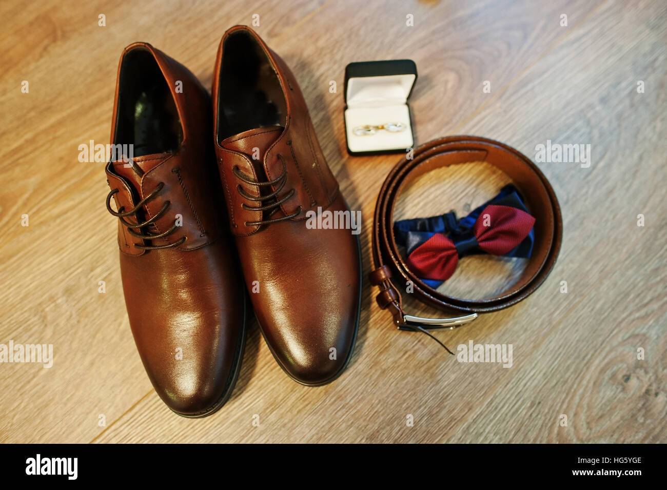 9e97549b7a67 Brown leather men's shoes with belt, bow tie and cufflinks. Set of groom  accessories on wedding day.