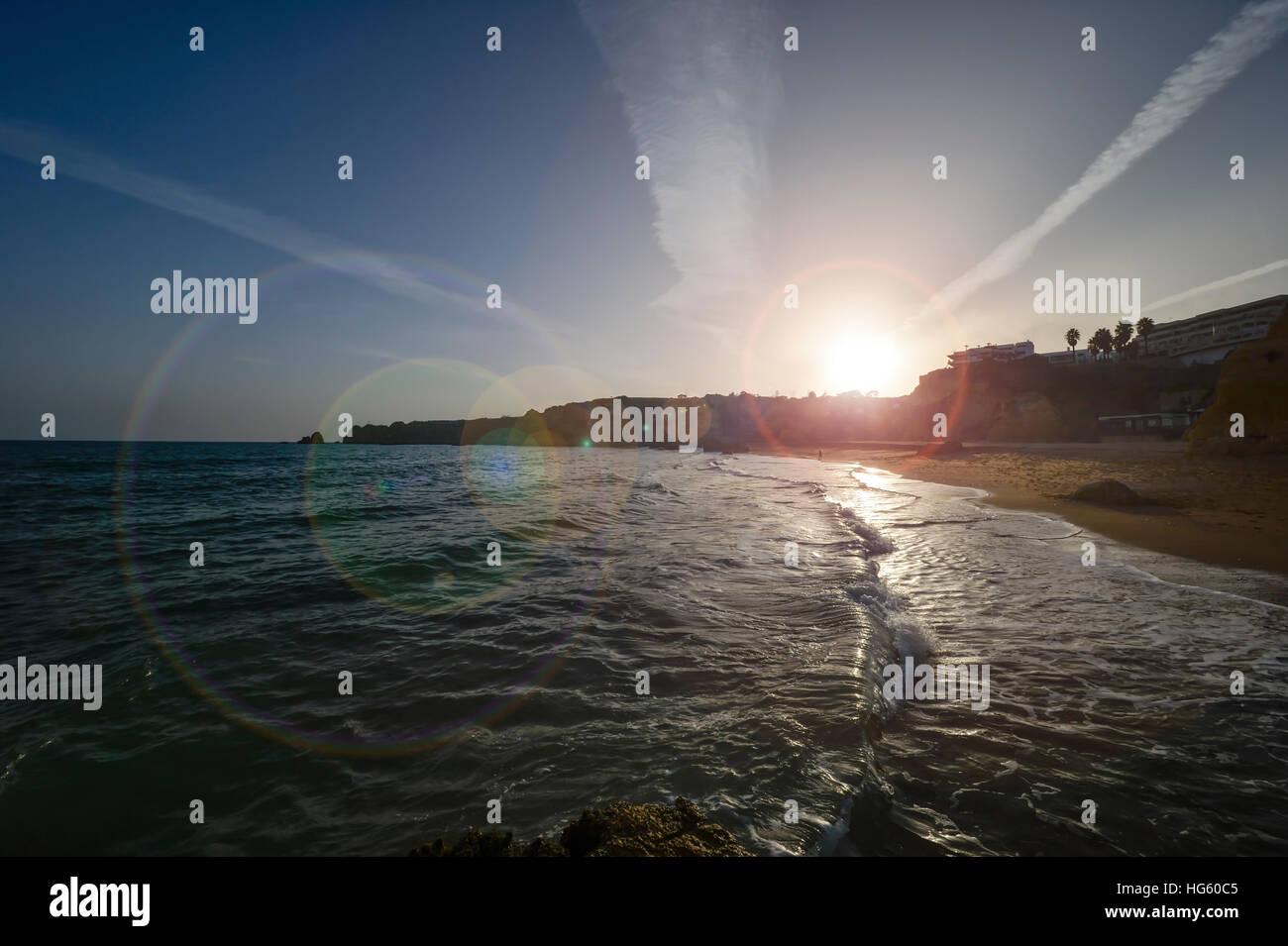 sunsetting at Dona Ana beach Lagos Portugal - Stock Image