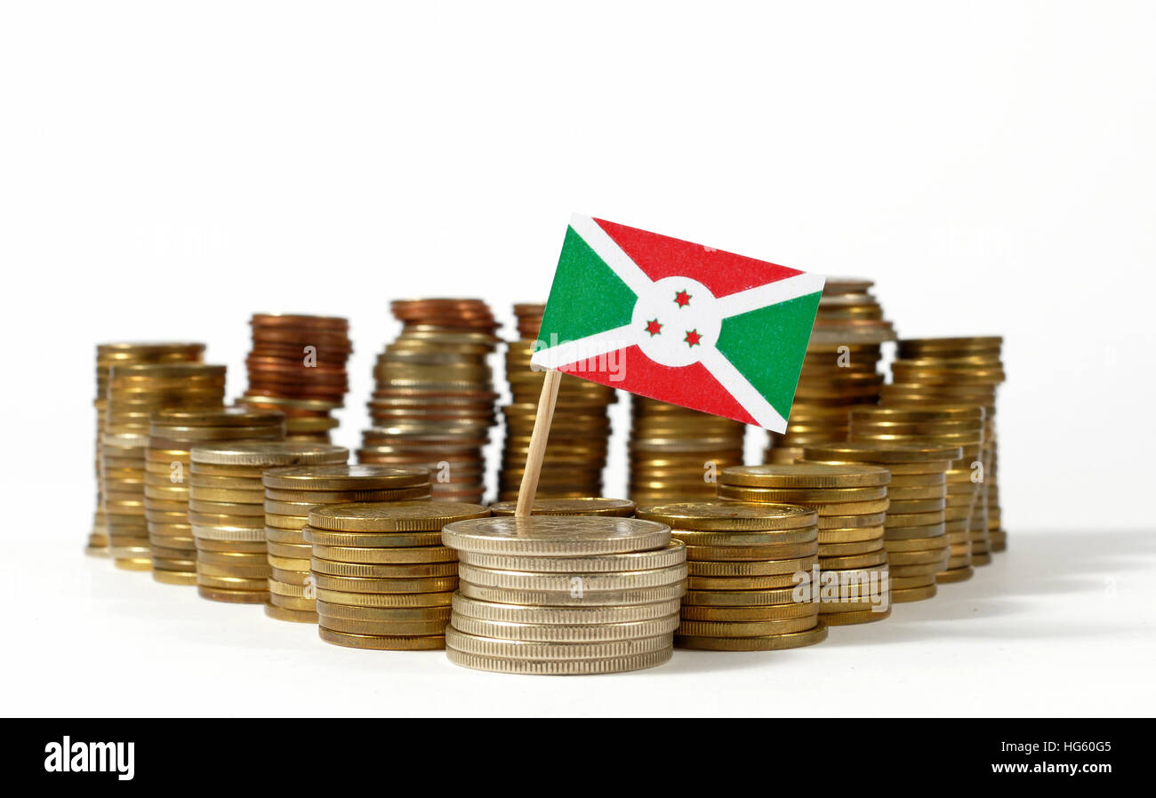 Burundi flag waving with stack of money coins - Stock Image
