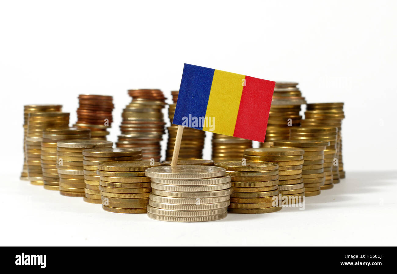Chad flag waving with stack of money coins - Stock Image