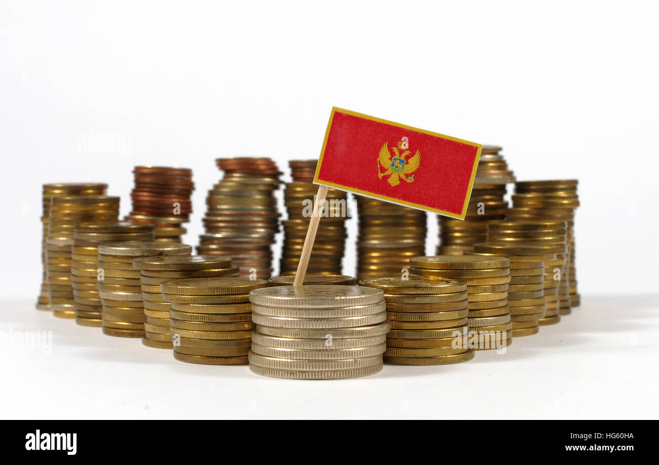 Montenegro flag waving with stack of money coins Stock Photo
