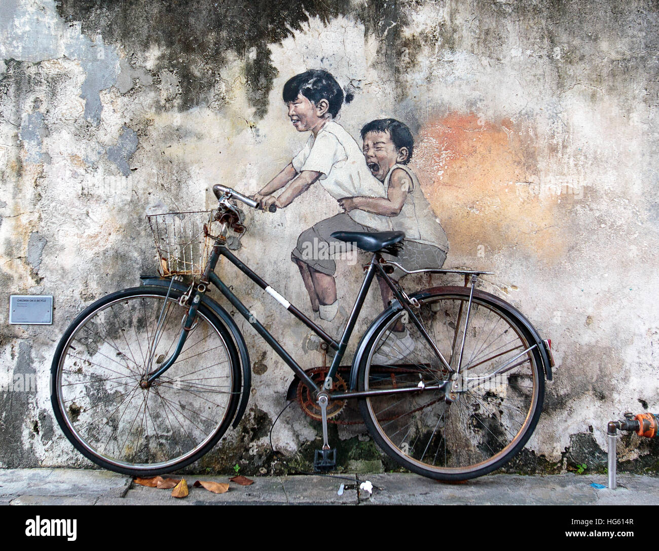 George Town, Penang, Malaysia - November 22: Street art mural by Lithuanian artist Ernest Zacharevic in Georgetown, - Stock Image