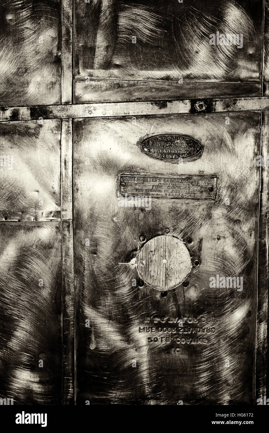 antique rough, scratchy steel door surface - Stock Image