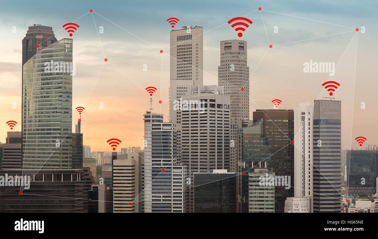 Concept of IOT and smart city illustrated by wireless networking and Wifi icon. - Stock Image