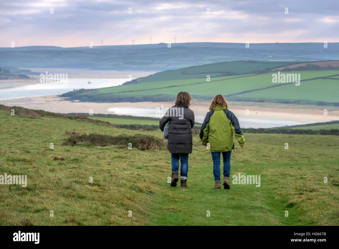 Two women walk at The Narrows near Padstow in Cornwall - Stock Image