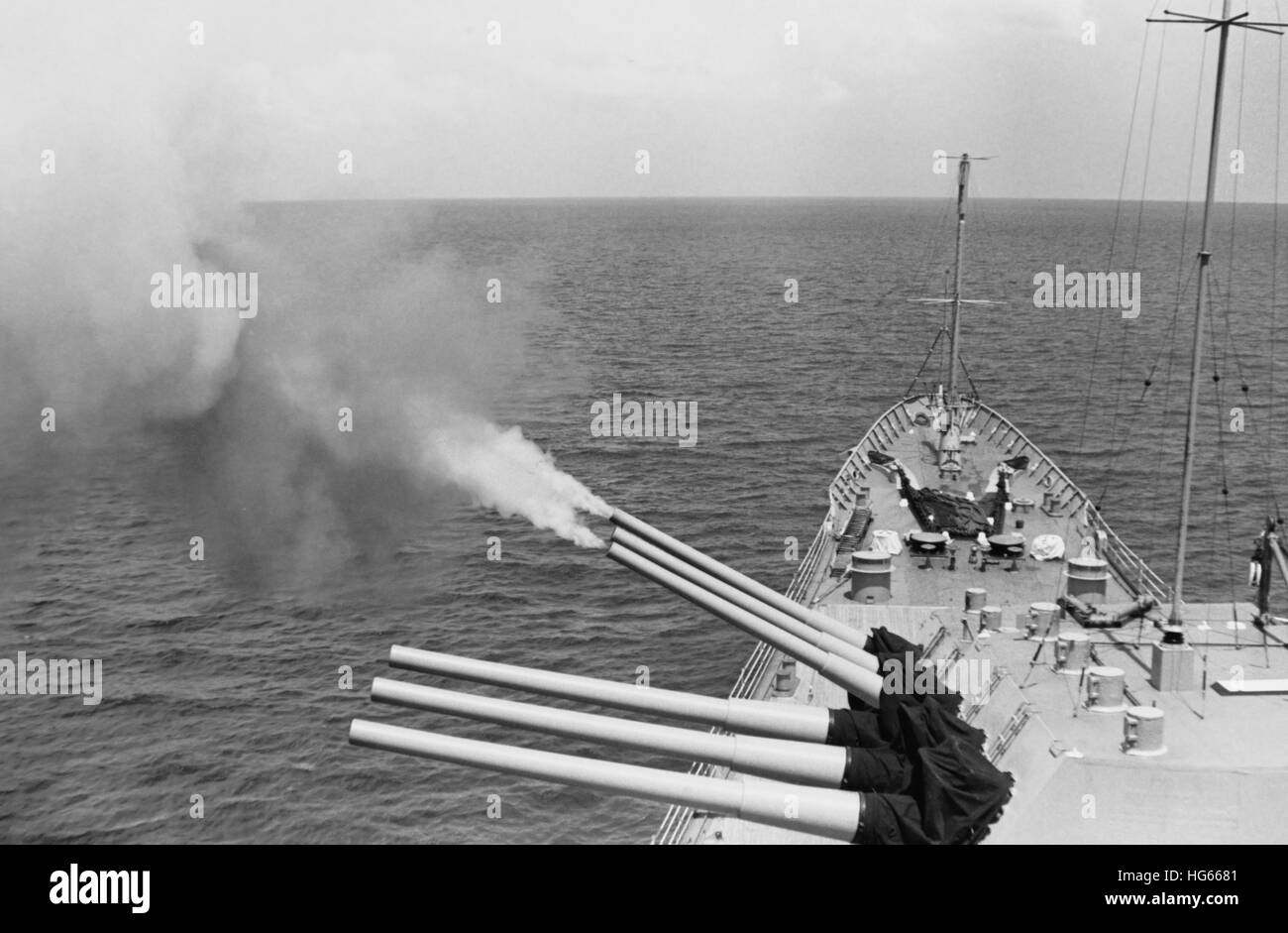 USS Boston's triple gun turret fires on North Vietnamese targets, Operation Sea Dragon, 1968. - Stock Image
