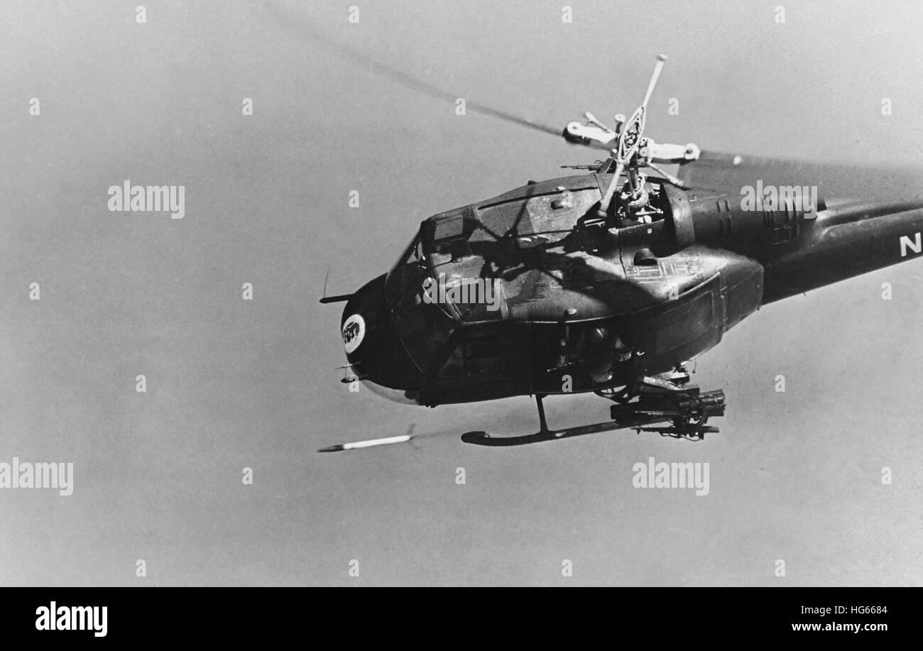 A UH-1 helicopter gunship fires a 2.75-inch rocket, Vietnam War, 1969. - Stock Image