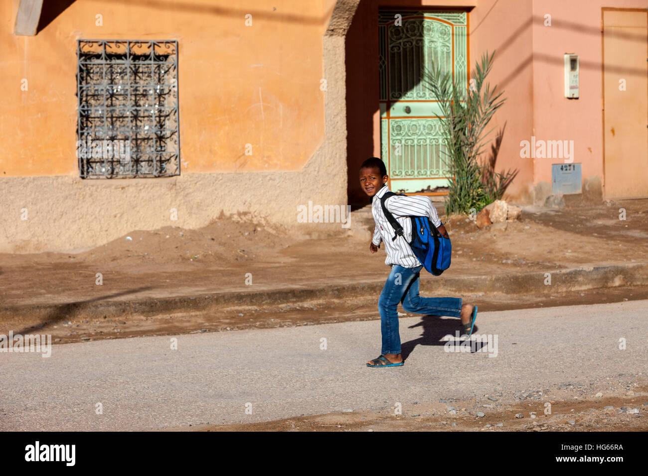Elkhorbat, Morocco.  Boy Hurrying to School. - Stock Image
