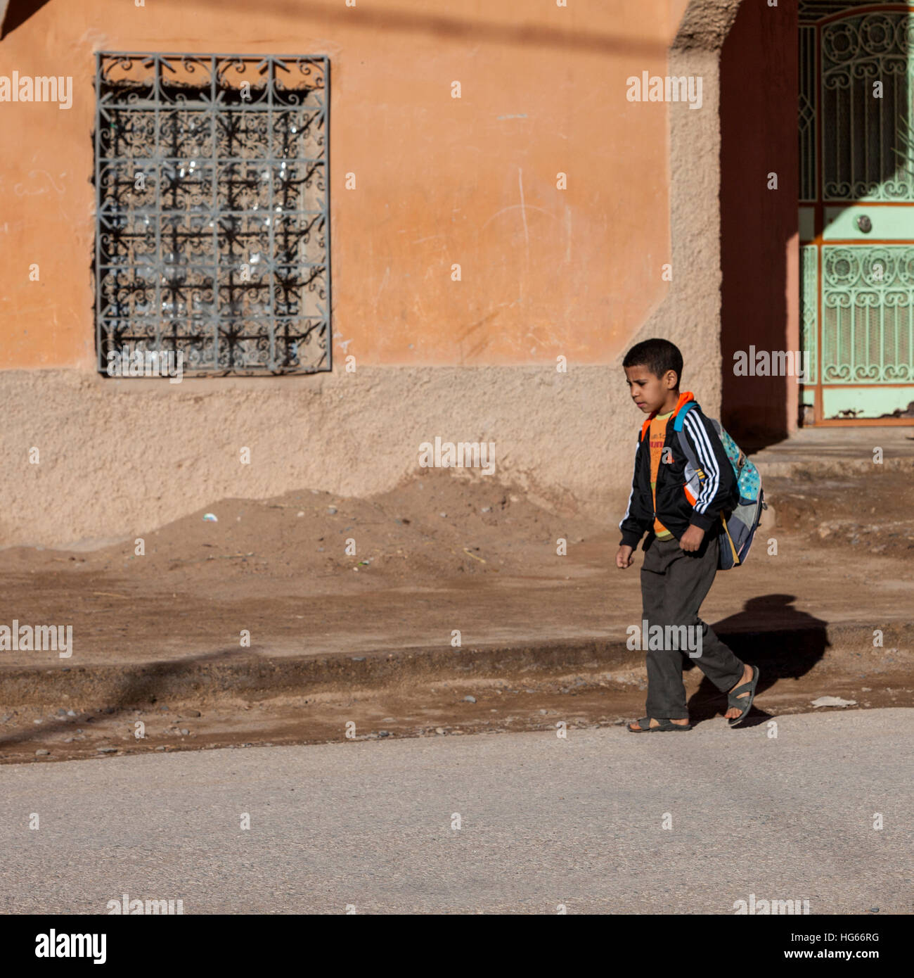 Elkhorbat, Morocco.  Afro-Berber Boy Heading to School. - Stock Image