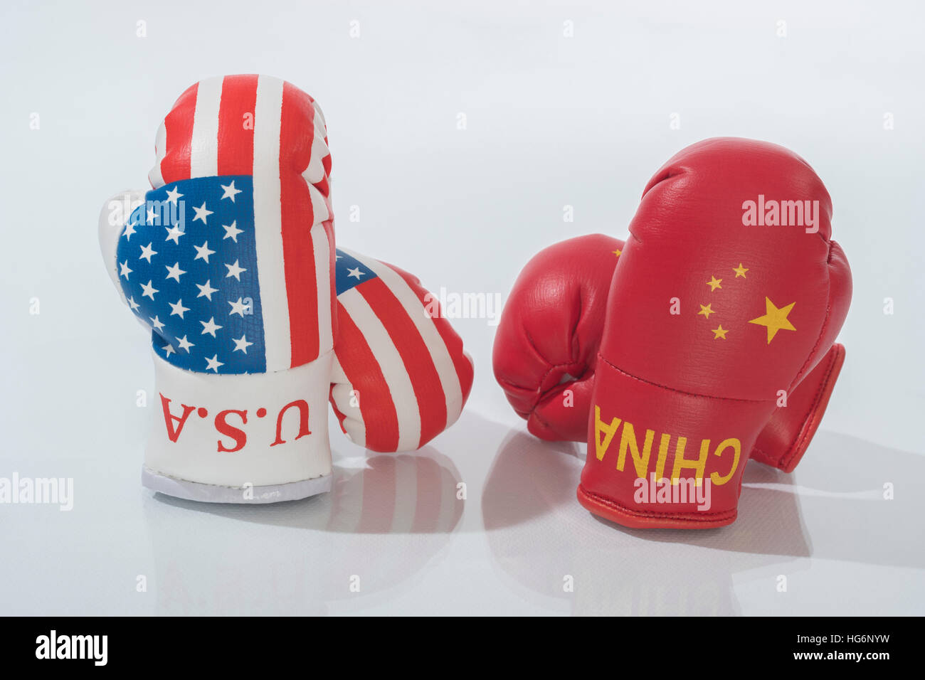 Mini US Stars & Stripes boxing gloves - metaphor for concept of US-Chinese tensions, US China trade war, tariff - Stock Image