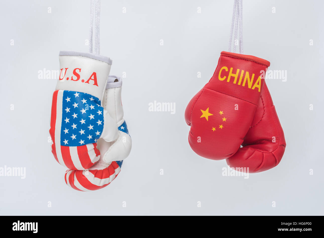 Mini US Stars & Stripes boxing gloves - metaphor for concept US-Chinese tensions, US China trade war, tariff - Stock Image