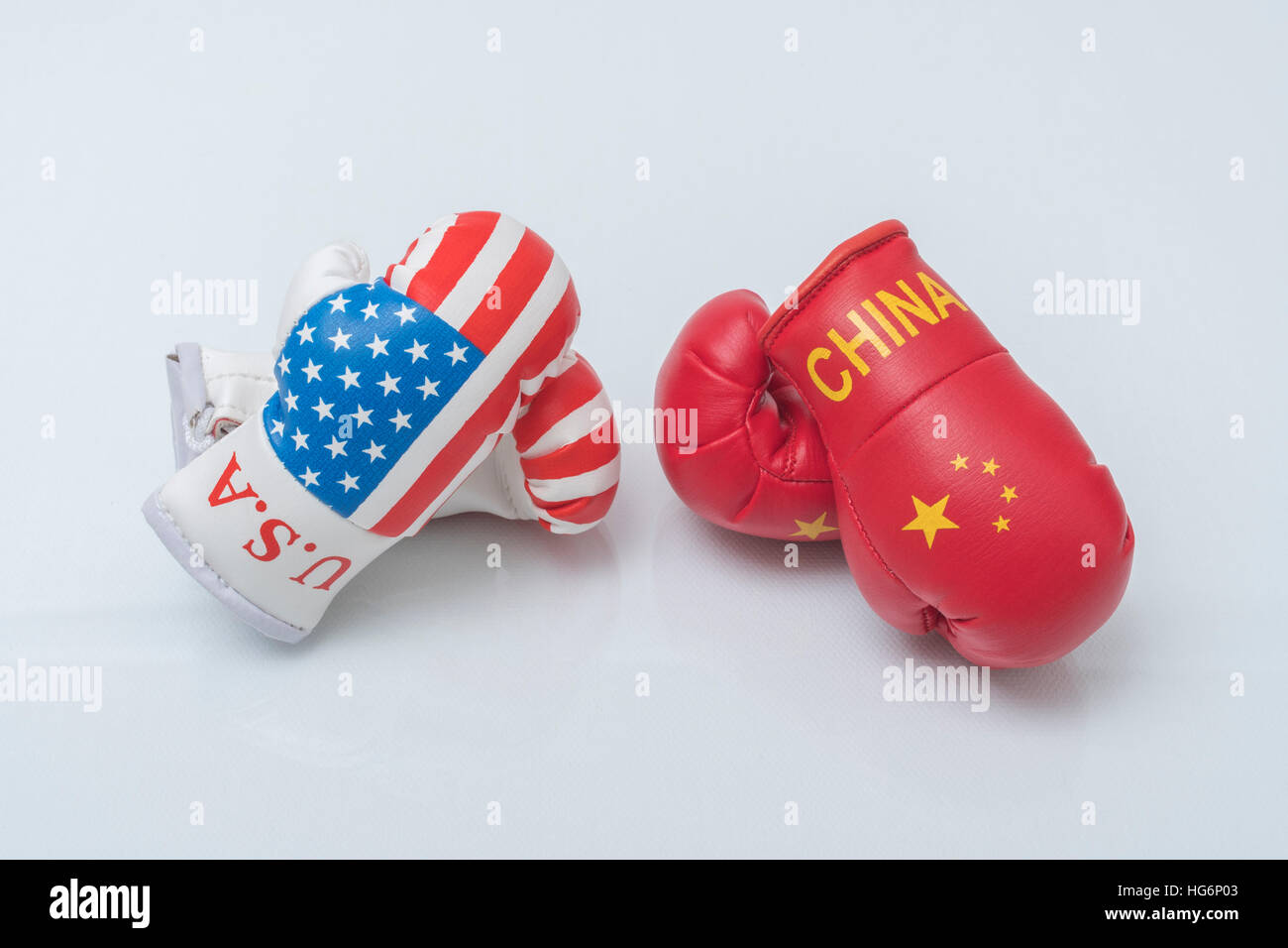 Mini US Stars & Stripes boxing gloves - as visual metaphor for concept of US-Chinese tensions, US China trade - Stock Image