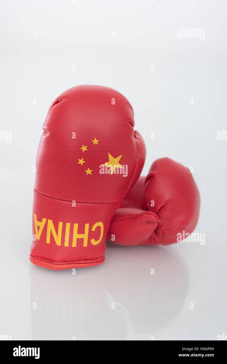 Mini Chinese boxing gloves - as visual metaphor for concept of US-Chinese tensions, trade war, antagonism, standoff. - Stock Image