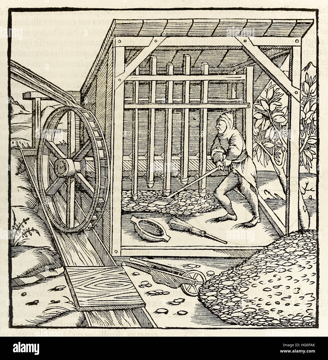 Mining with water wheel, woodcut from 1550 edition of 'Cosmographia' by  Sebastian Munster (1488-1552). See description - Stock Image