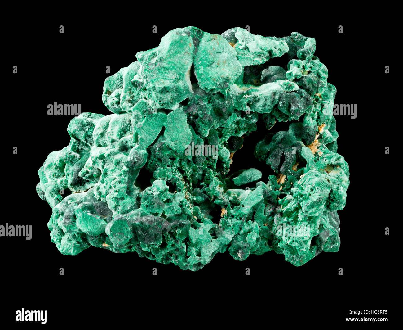 Raw, uncut malachite (cu2co3(oh)2) isolated on black background - Stock Image