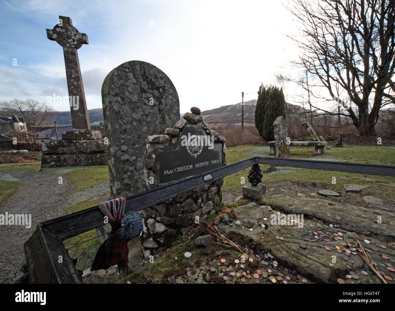 Balquhidder,Sterling,Scotland, UK - Rob Roy Red MacGregors resting place and cross,coins - Stock Image