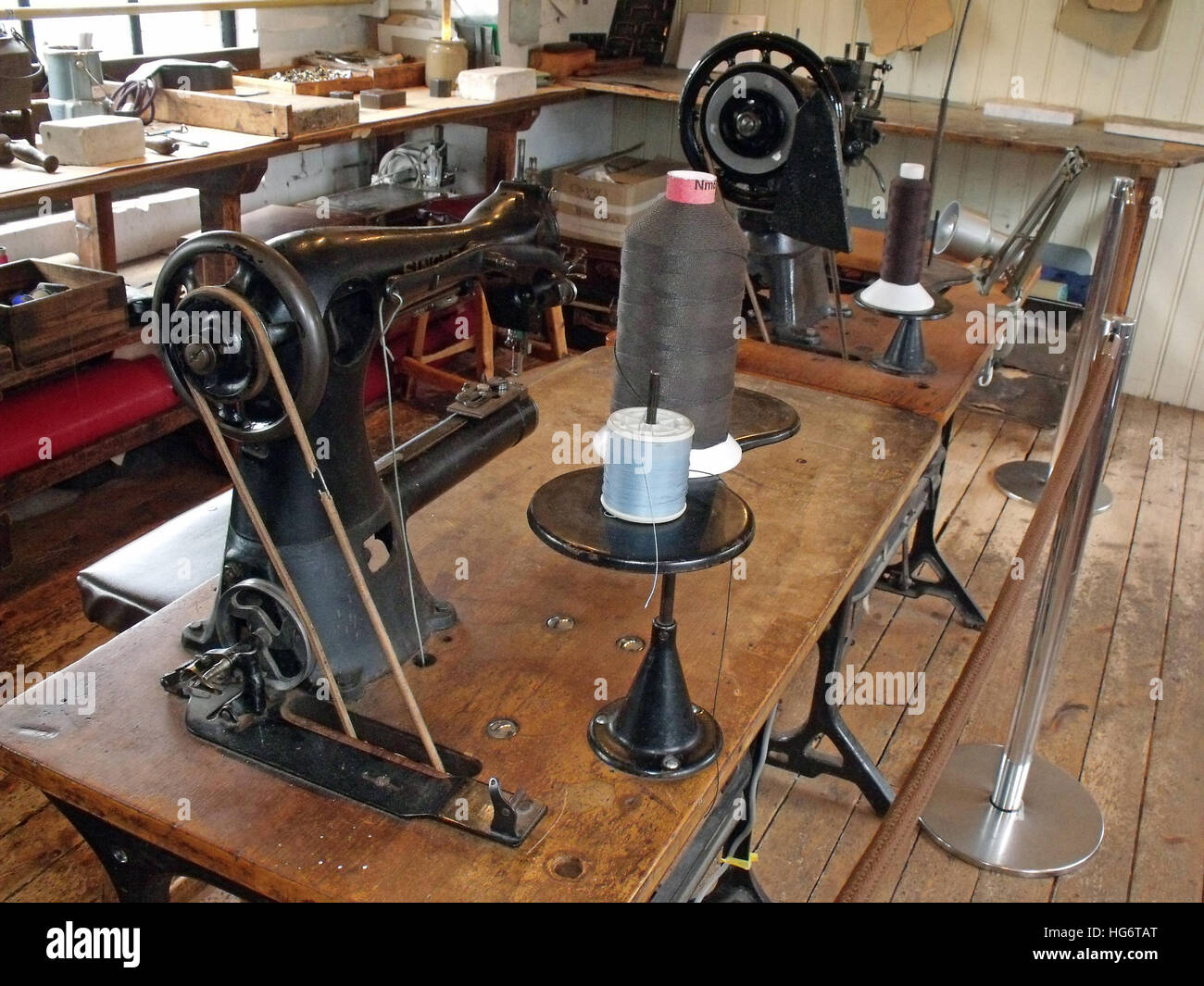 Motorised Sewing machine in a leather workshop,Walsall,west Midlands,England,UK - Stock Image