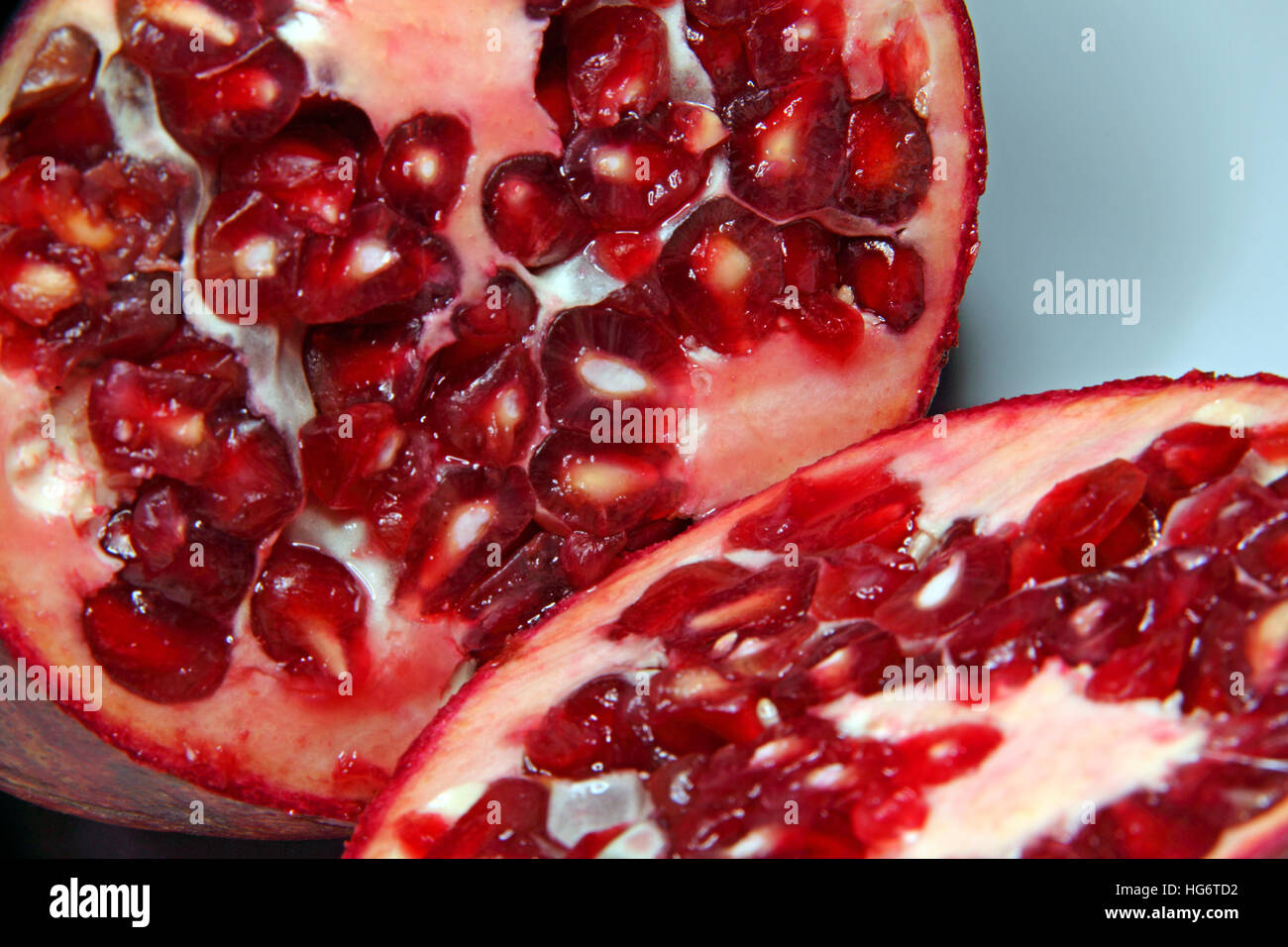 Red Pomegranate Fruit - cut open - Stock Image